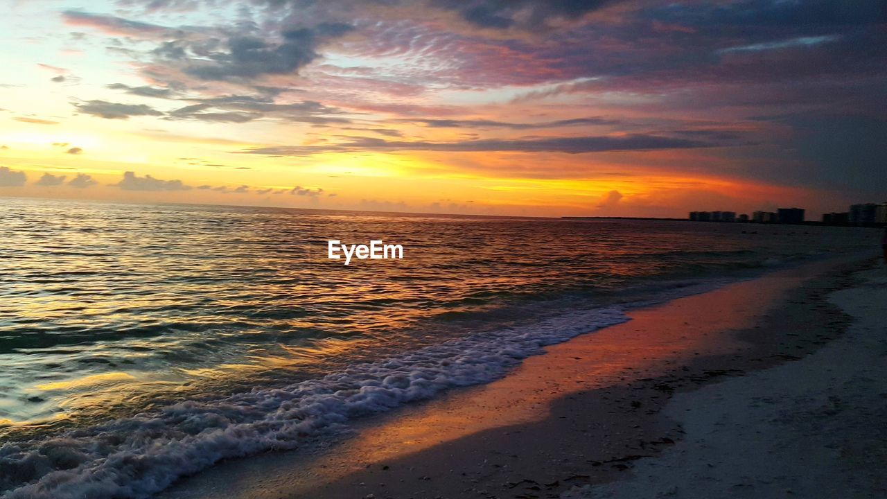 sunset, sky, water, sea, beach, beauty in nature, cloud - sky, scenics - nature, orange color, land, tranquility, tranquil scene, horizon, wave, horizon over water, idyllic, no people, nature, aquatic sport, outdoors