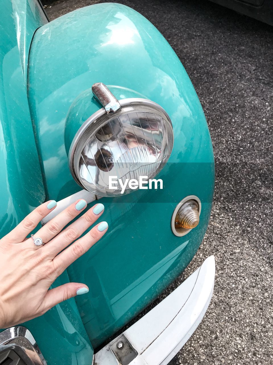 Cropped hand touching car