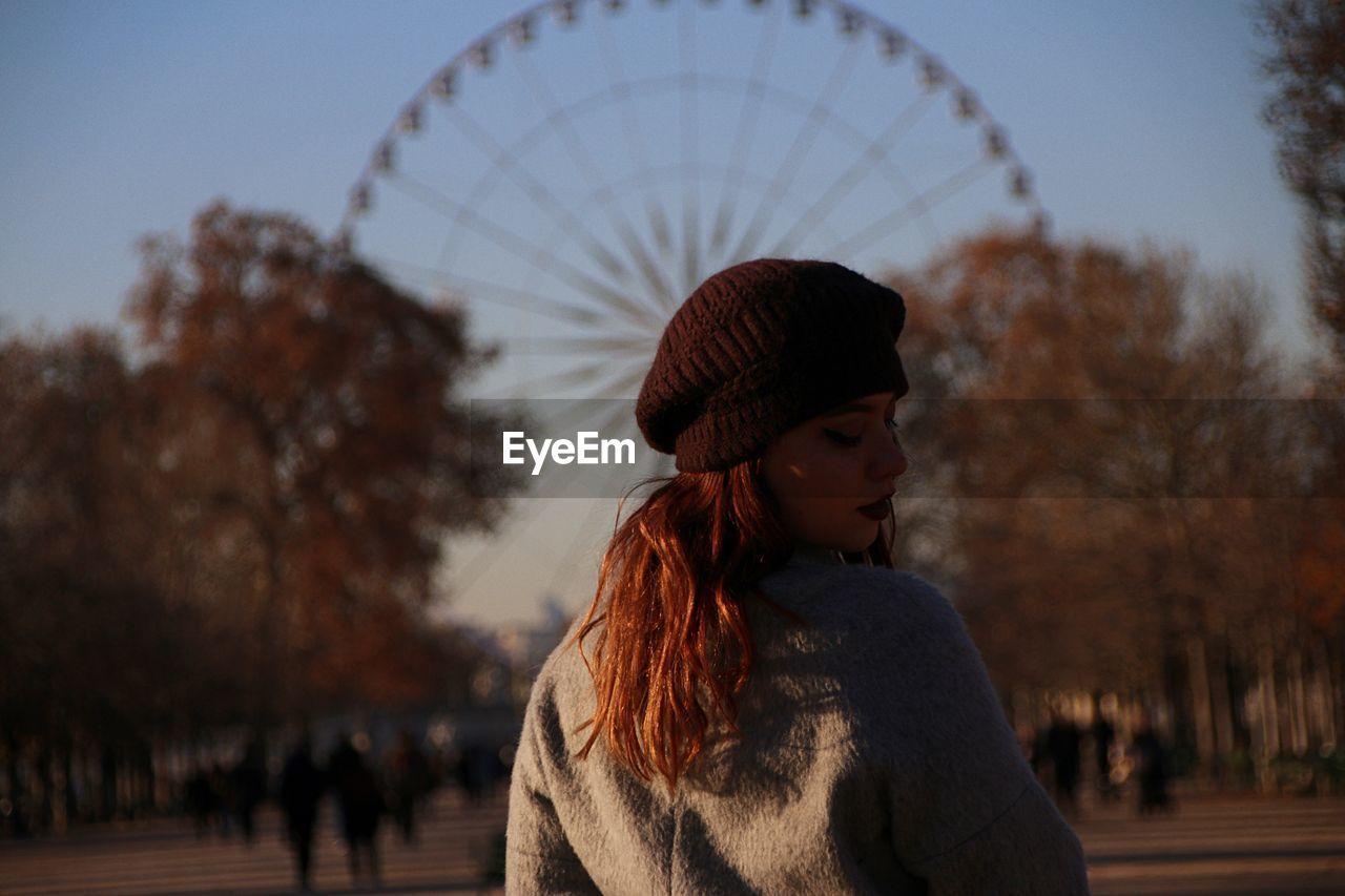 Woman Looking Over Shoulder In City