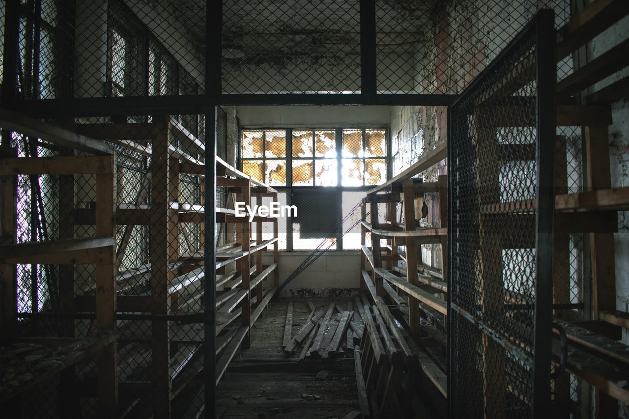 architecture, indoors, built structure, building, no people, window, day, abandoned, industry, wood - material, metal, nature, absence, staircase, domestic room, warehouse, old, glass - material, transparent