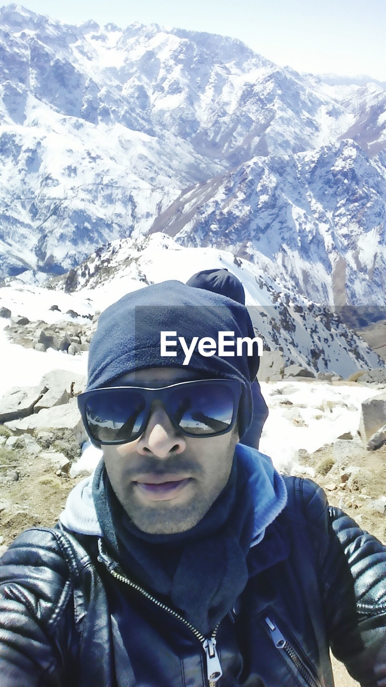 winter, mountain, cold temperature, snow, lifestyles, leisure activity, warm clothing, young adult, headshot, mountain range, season, young men, looking at camera, portrait, person, sunglasses, men, casual clothing