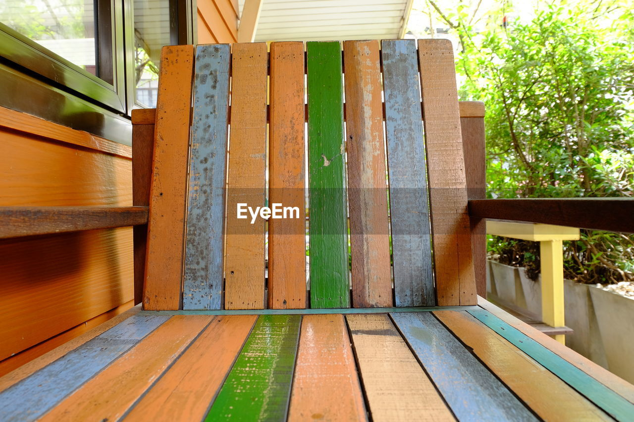 wood - material, architecture, no people, built structure, day, wood, plank, tree, outdoors, plant, nature, porch, house, green color, seat, window, sunlight, brown