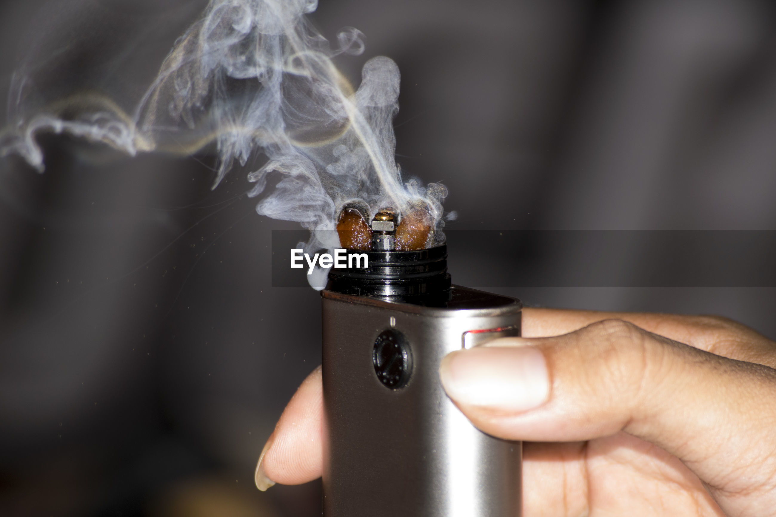 Close-up of woman holding electronic cigarette
