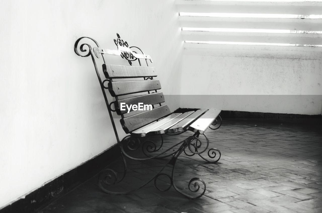 Empty bench in building