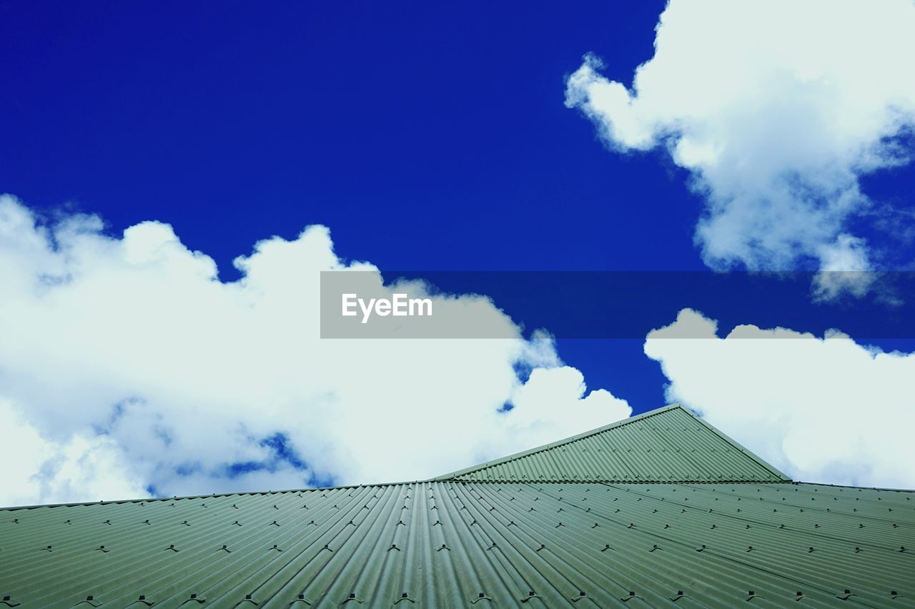 sky, cloud - sky, built structure, low angle view, day, blue, architecture, roof, outdoors, no people, building exterior, nature