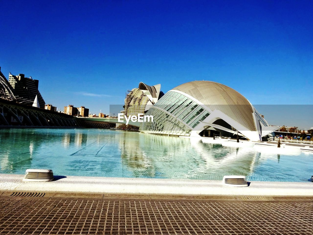 water, architecture, travel destinations, built structure, building exterior, swimming pool, tourism, outdoors, travel, blue, vacations, day, sculpture, no people, city, concert hall, sky