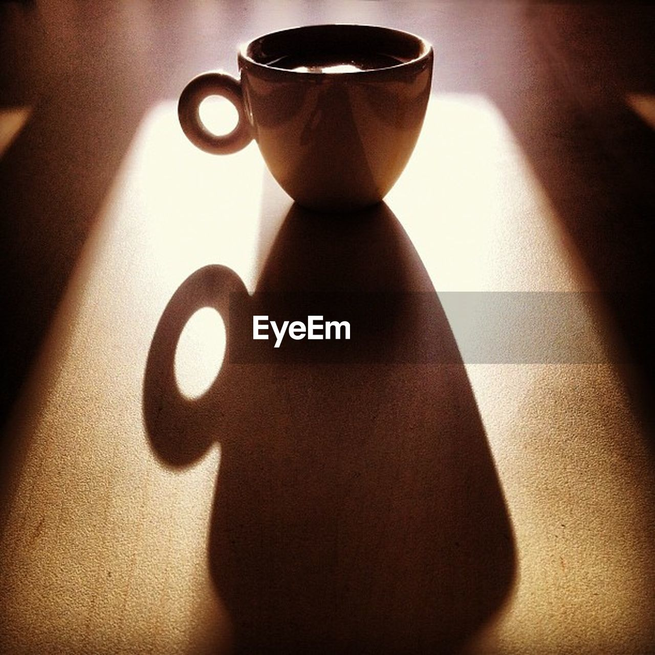 shadow, coffee cup, table, cup, indoors, food and drink, drink, refreshment, sunlight, coffee - drink, no people, tea - hot drink, close-up, healthy eating, day, freshness, food