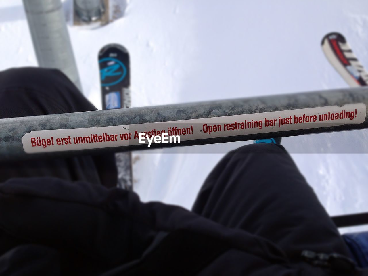 Close-up of person with text on railing