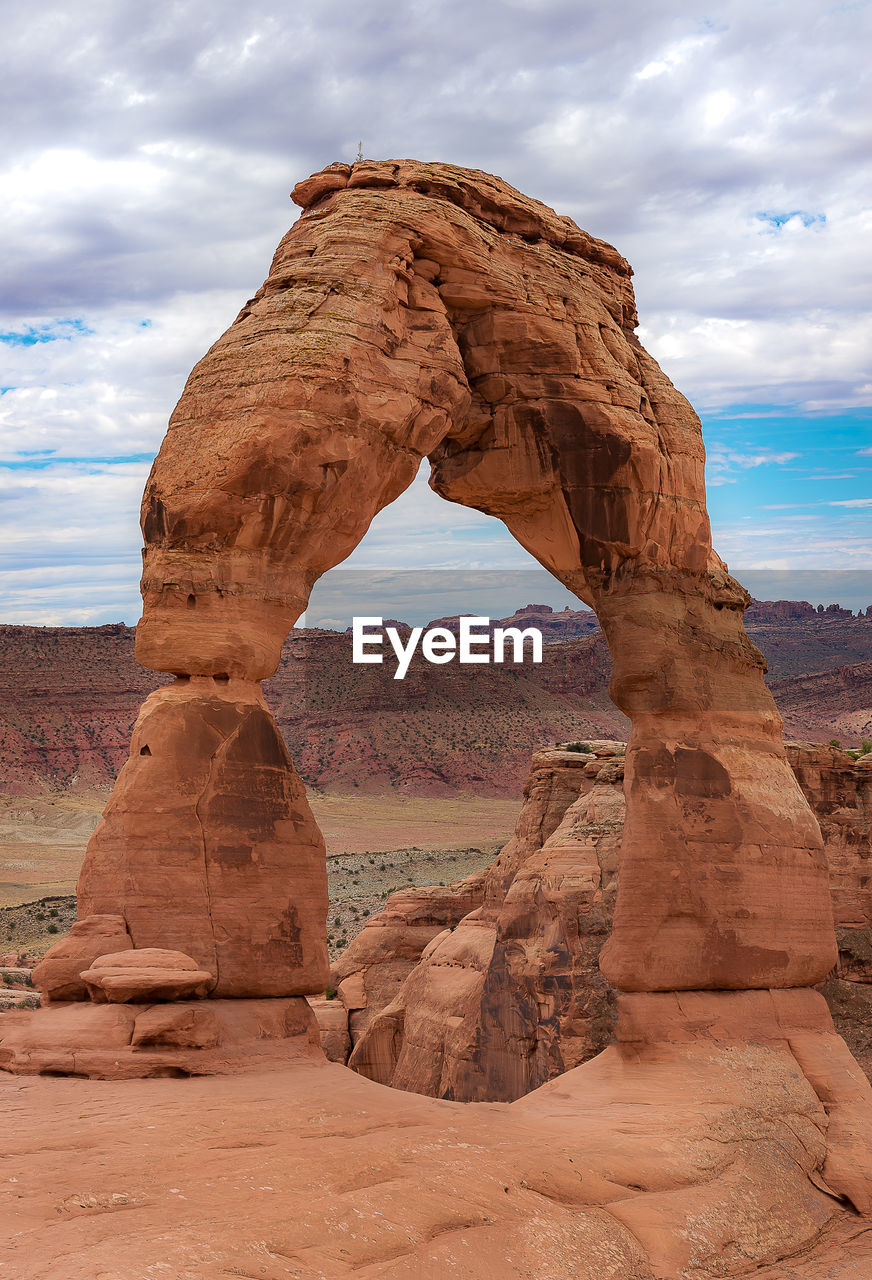 rock formation, rock, cloud - sky, rock - object, sky, physical geography, solid, geology, tranquility, beauty in nature, tranquil scene, scenics - nature, land, natural arch, remote, non-urban scene, no people, nature, travel destinations, arch, climate, arid climate, eroded, outdoors, sandstone