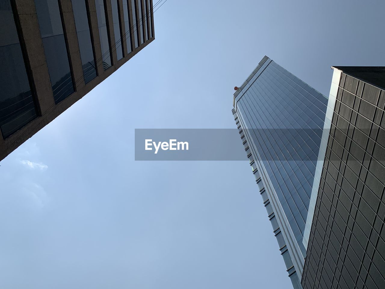 built structure, architecture, building exterior, sky, building, low angle view, office building exterior, skyscraper, office, city, tall - high, modern, day, nature, no people, tower, outdoors, clear sky, blue, glass - material, directly below, financial district