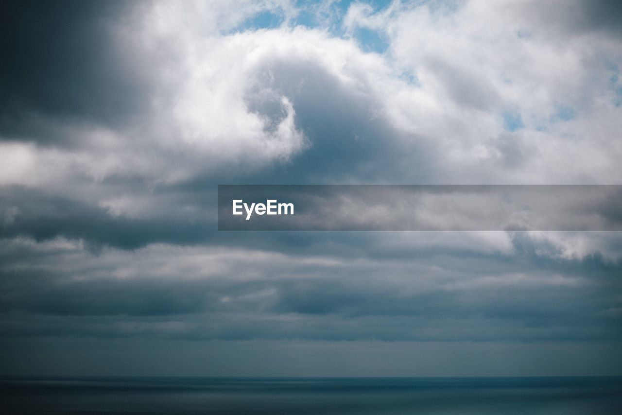 SCENIC VIEW OF CLOUDS OVER SEA