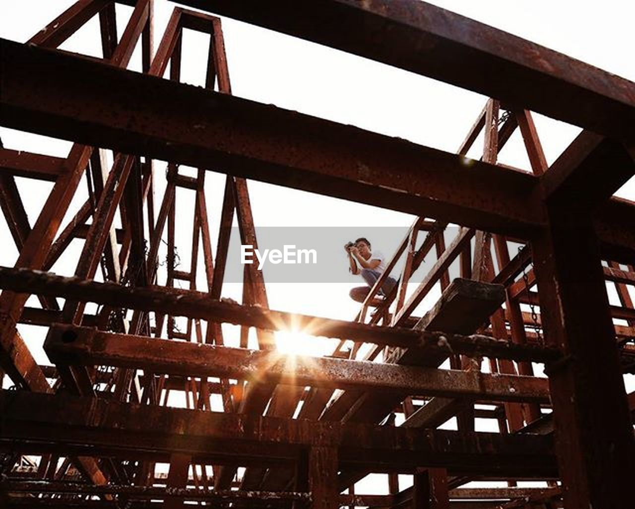 sun, sunlight, sunbeam, lens flare, low angle view, girder, bridge - man made structure, steel, built structure, no people, day, architecture, outdoors, sky, metal industry