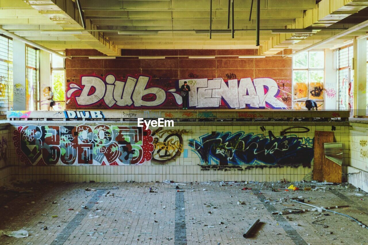 graffiti, text, architecture, built structure, no people, day, indoors