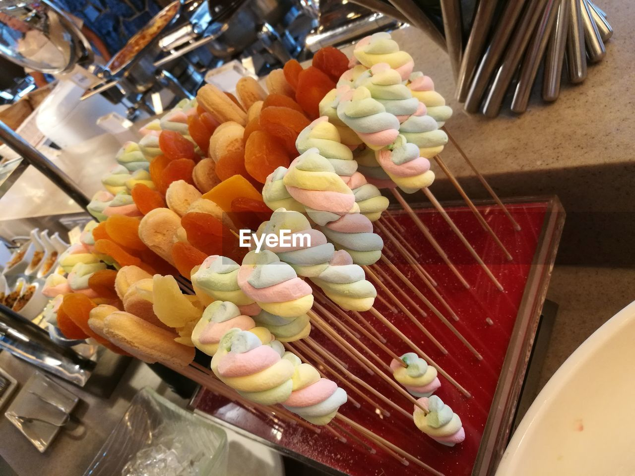 food, food and drink, sweet food, freshness, sweet, indoors, choice, variation, multi colored, no people, business, retail, indulgence, large group of objects, still life, skewer, arrangement, high angle view, dessert, temptation, order, retail display, tray