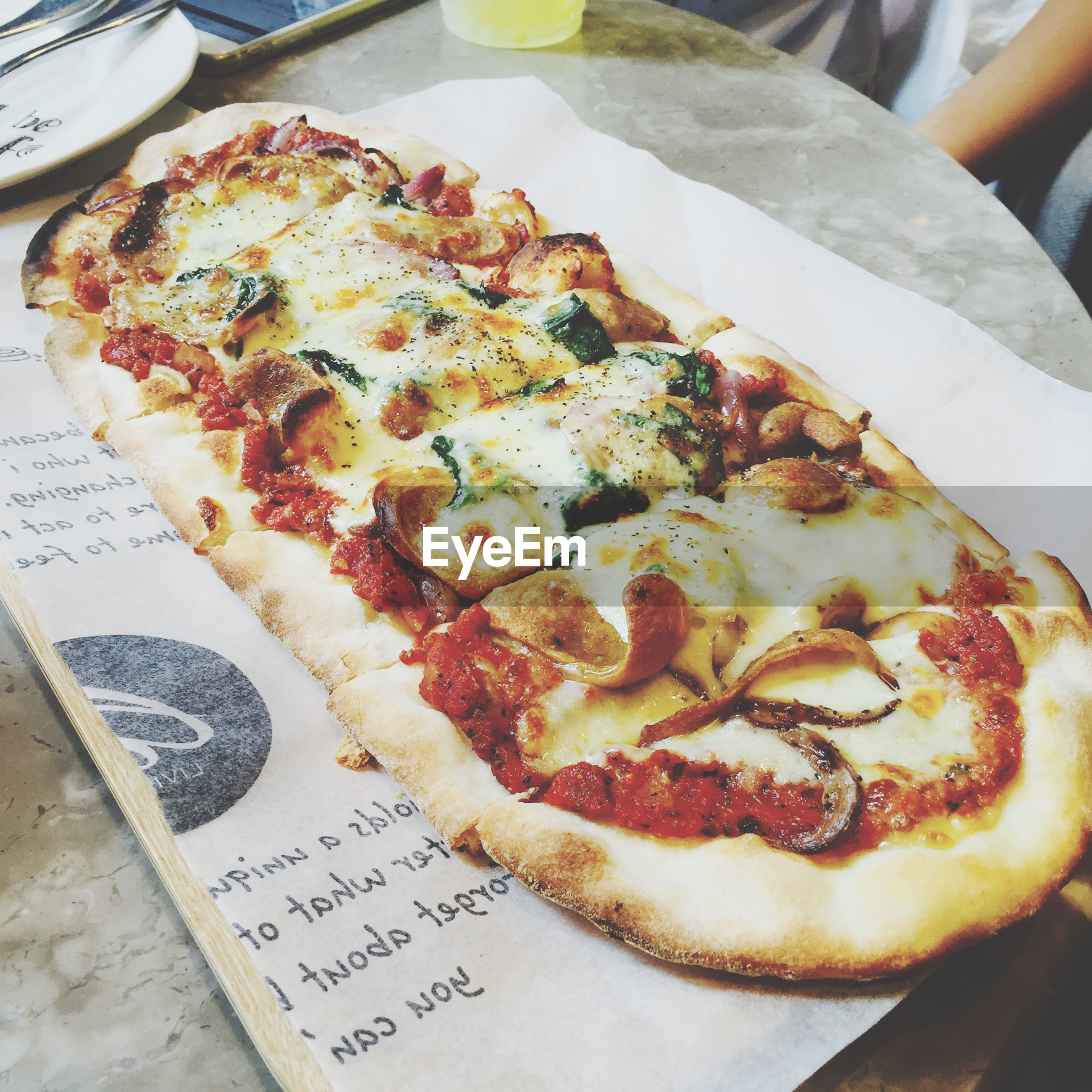 food and drink, food, freshness, indoors, ready-to-eat, still life, unhealthy eating, indulgence, close-up, pizza, plate, high angle view, meat, table, serving size, meal, bread, temptation, snack