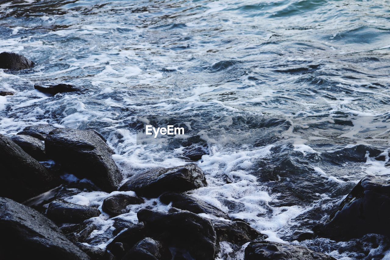 water, rock, motion, rock - object, solid, sea, beauty in nature, no people, nature, day, sport, land, wave, aquatic sport, blurred motion, scenics - nature, outdoors, beach, flowing water, flowing, power in nature, rocky coastline, breaking