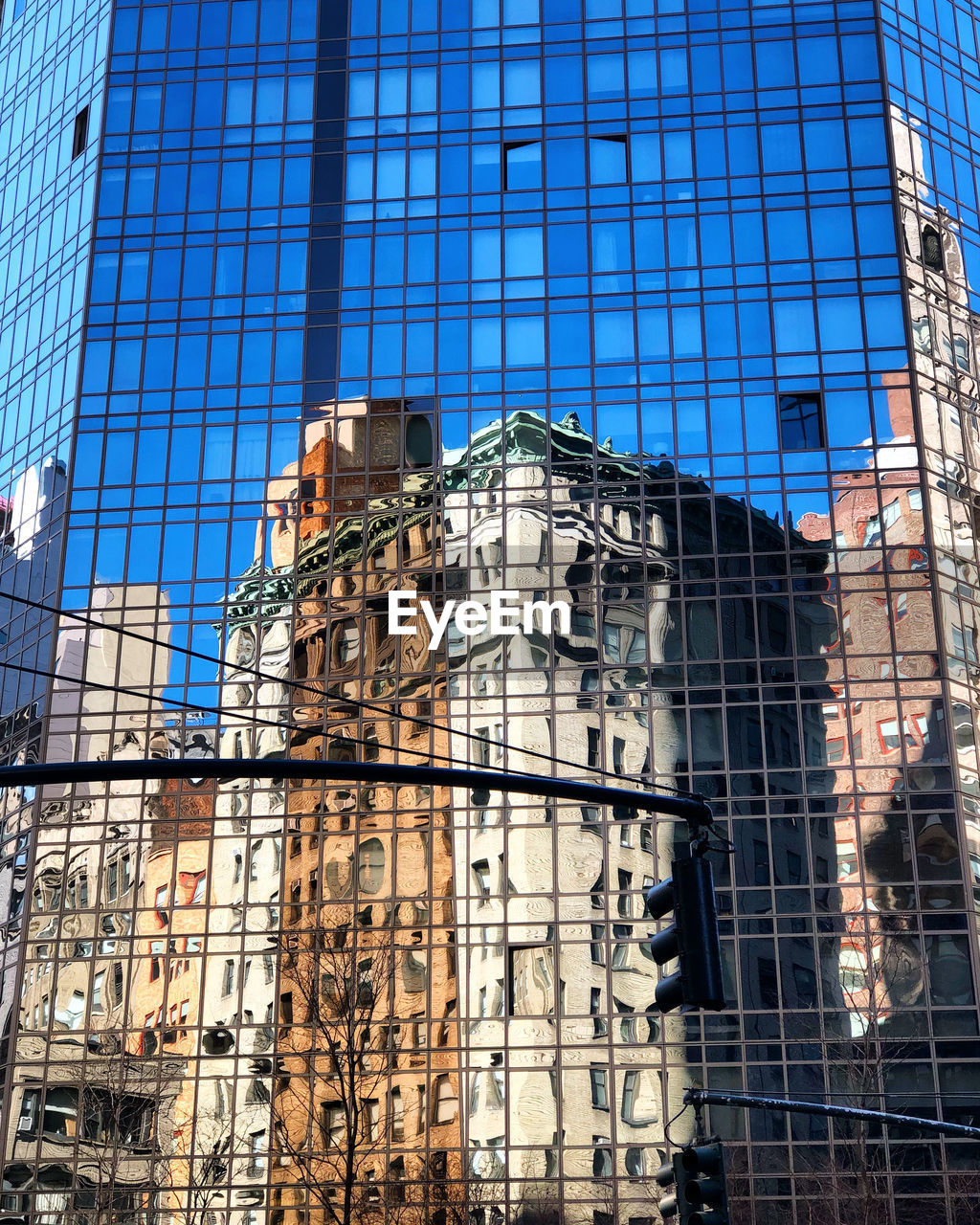architecture, built structure, glass - material, building exterior, low angle view, building, city, reflection, modern, day, window, office building exterior, office, no people, outdoors, nature, blue, sky, sunlight, tower, skyscraper, financial district