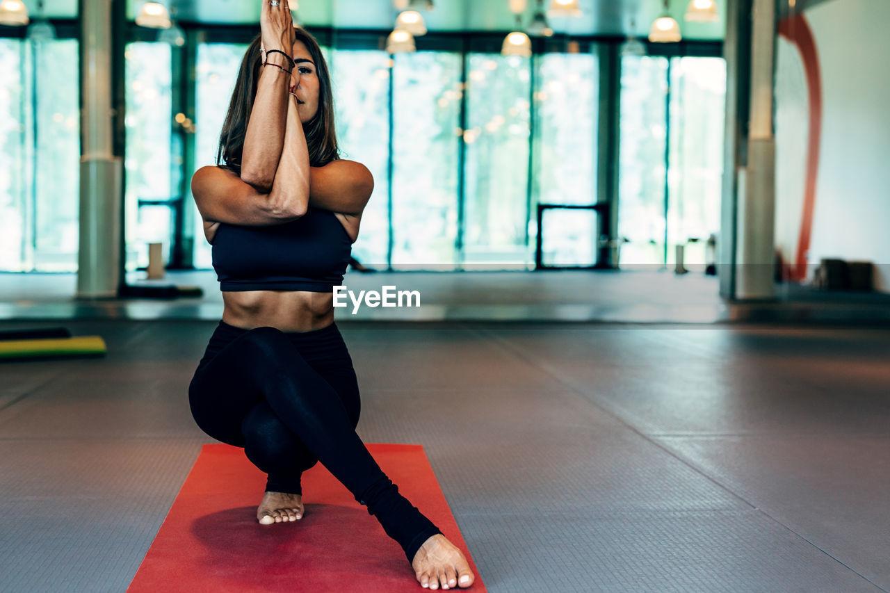 Woman doing yoga on exercise mat