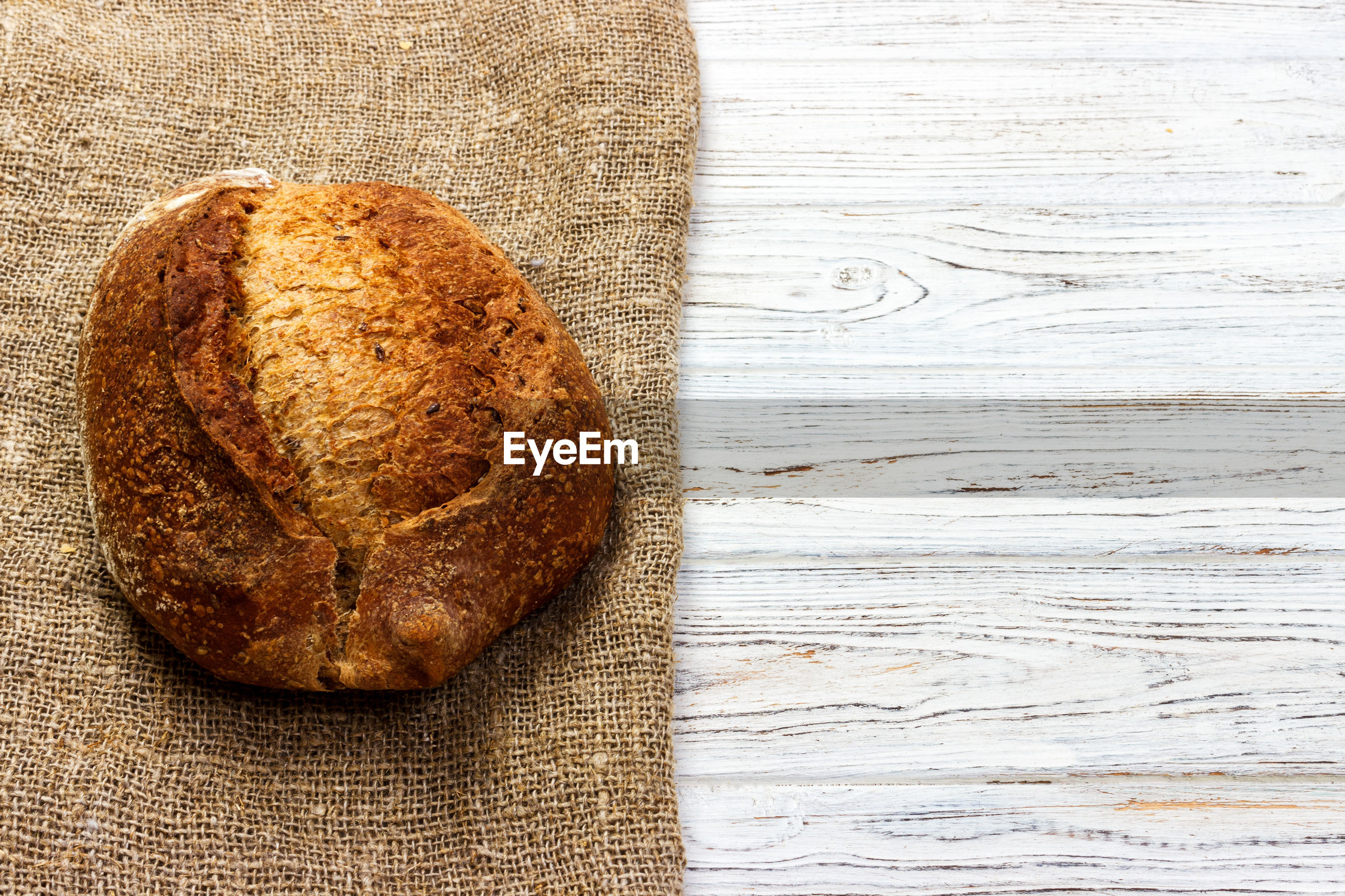 High angle view of bread and burlap on table