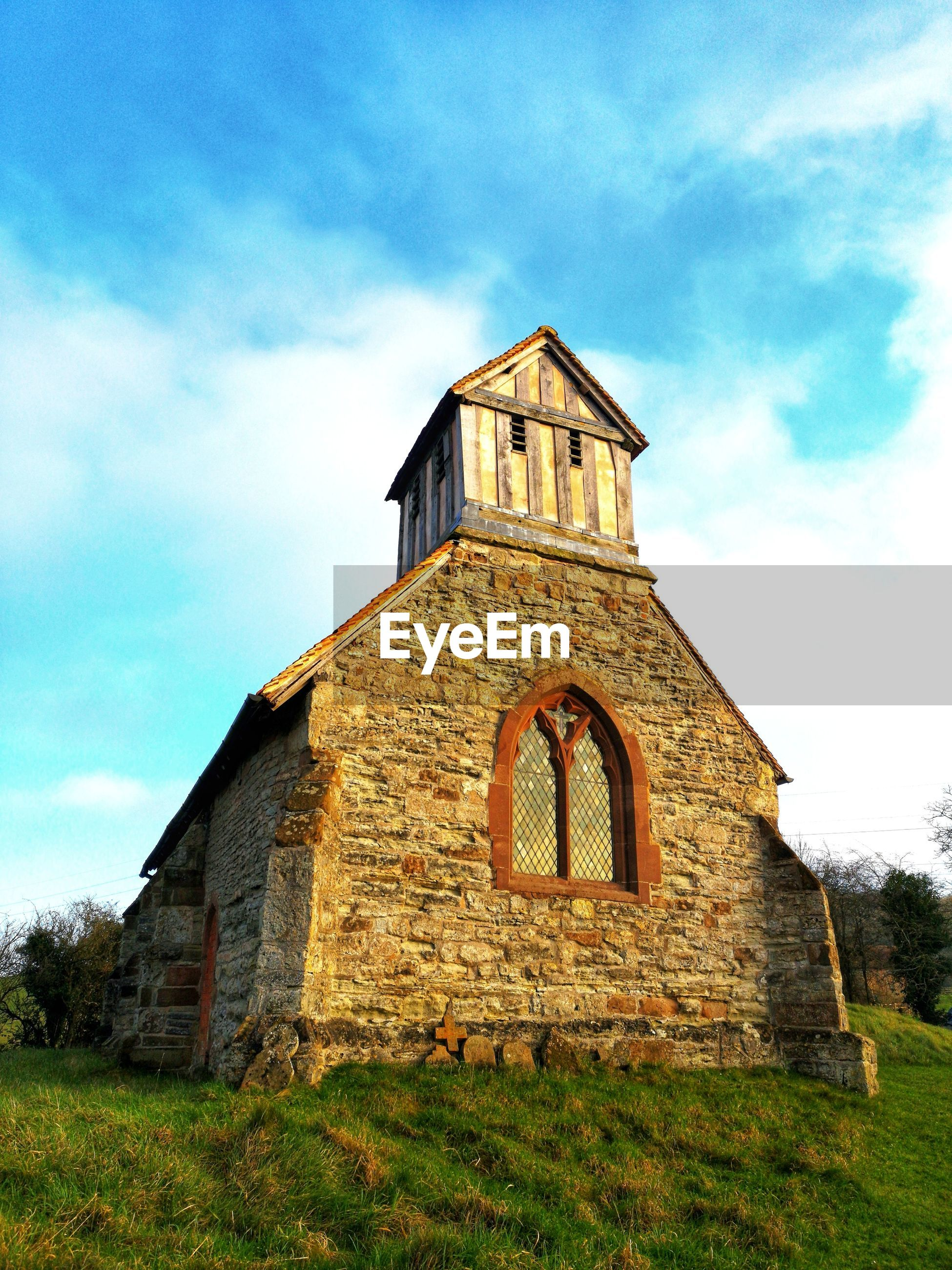 Low angle view of an old 13th century church against sky