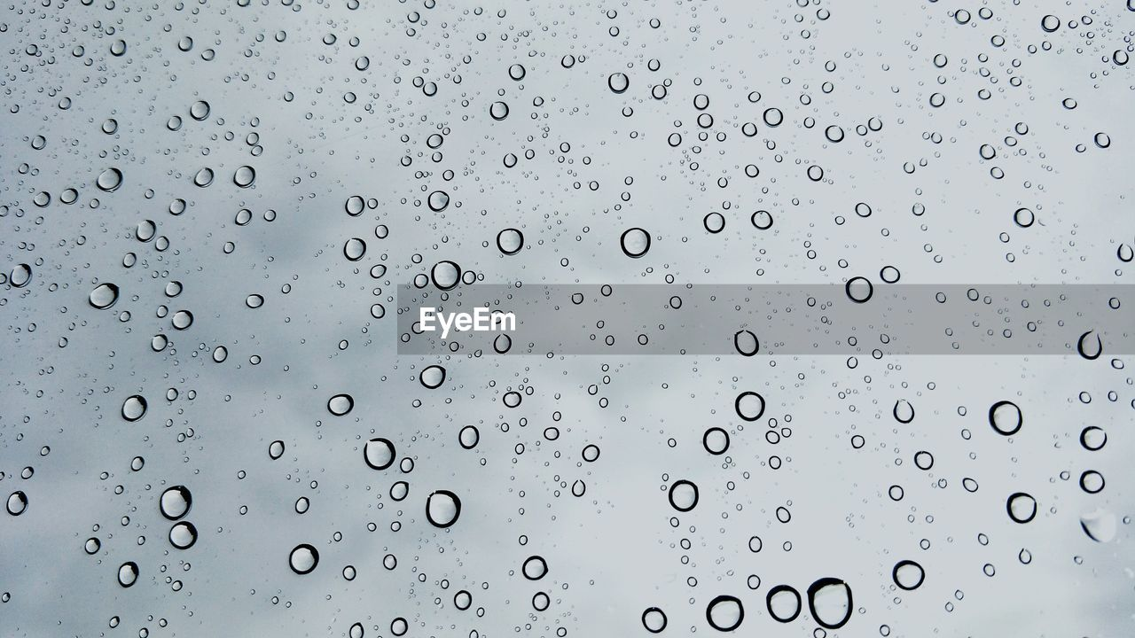 drop, wet, water, rain, backgrounds, full frame, glass - material, window, no people, transparent, nature, indoors, rainy season, raindrop, close-up, sky, day, purity