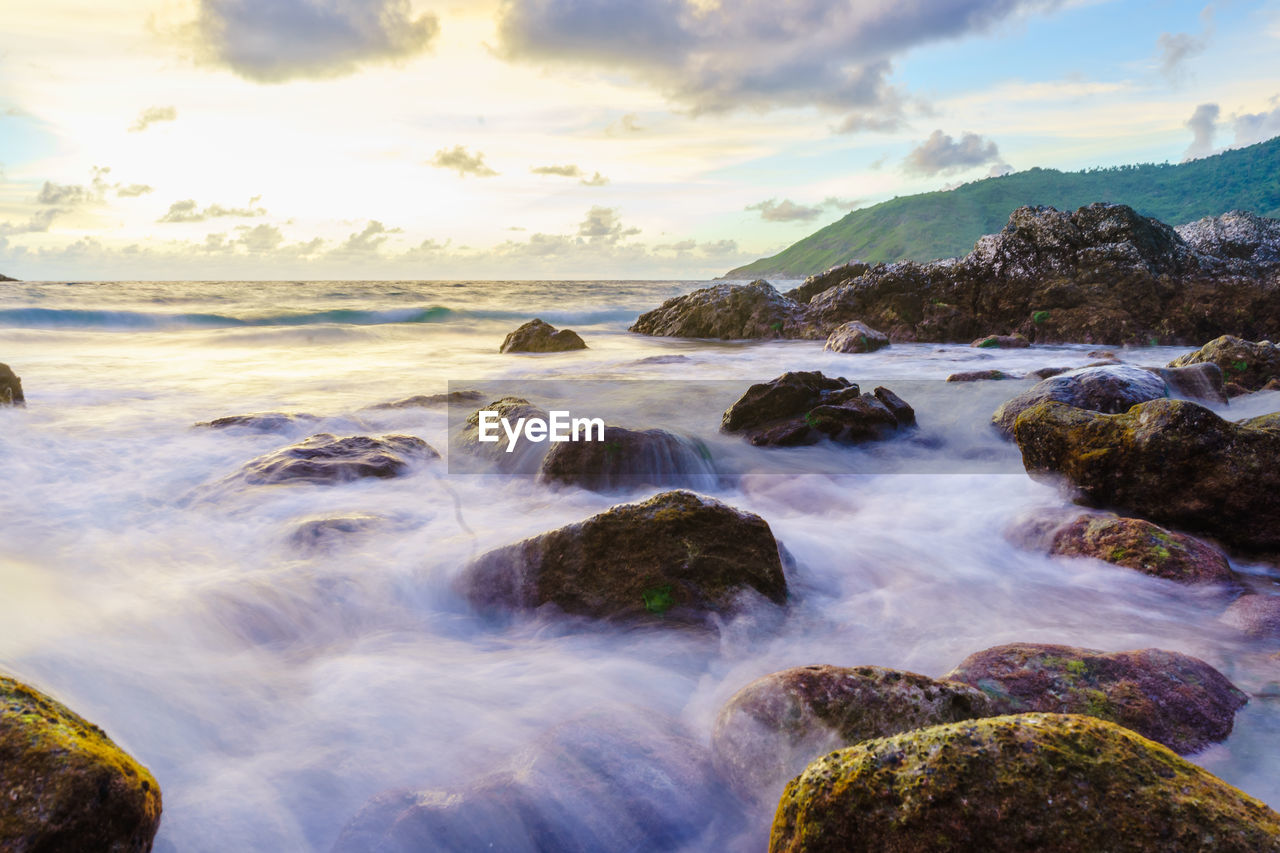 water, rock, beauty in nature, scenics - nature, sea, sky, solid, rock - object, motion, cloud - sky, long exposure, land, nature, no people, blurred motion, idyllic, tranquility, beach, tranquil scene, horizon over water, outdoors, flowing water