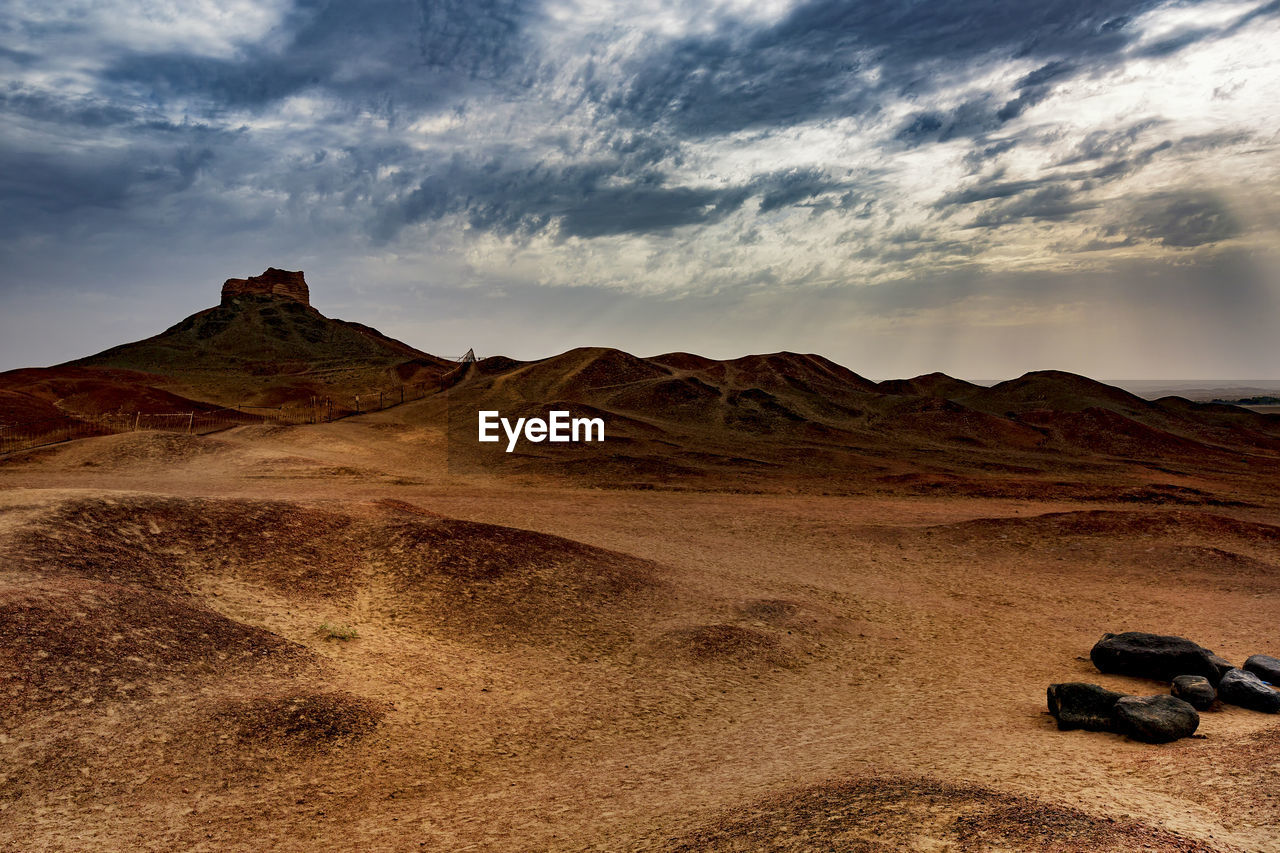 sky, cloud - sky, scenics - nature, tranquil scene, beauty in nature, tranquility, mountain, landscape, environment, non-urban scene, nature, land, no people, rock, idyllic, solid, remote, mountain range, rock - object, outdoors, climate, arid climate, eroded