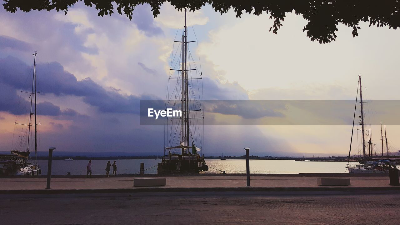 nautical vessel, sky, mast, transportation, sea, cloud - sky, outdoors, mode of transport, no people, sailboat, travel destinations, nature, water, day, scenics, harbor, tranquility, moored, beauty in nature, tree, tall ship, sailing ship