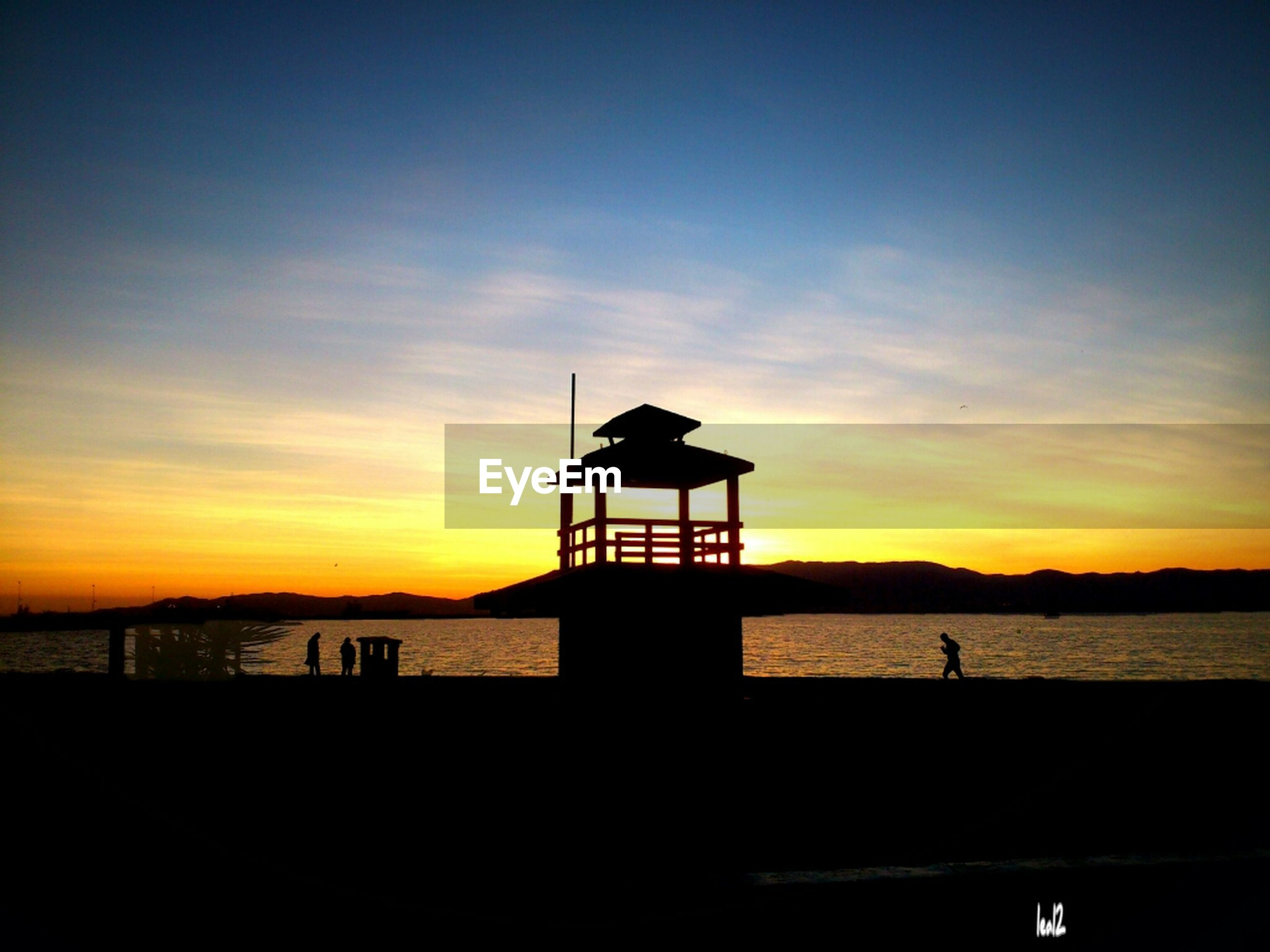 sunset, silhouette, sea, water, sky, horizon over water, scenics, orange color, beauty in nature, tranquility, tranquil scene, beach, built structure, idyllic, nature, architecture, pier, shore, cloud - sky, lighthouse