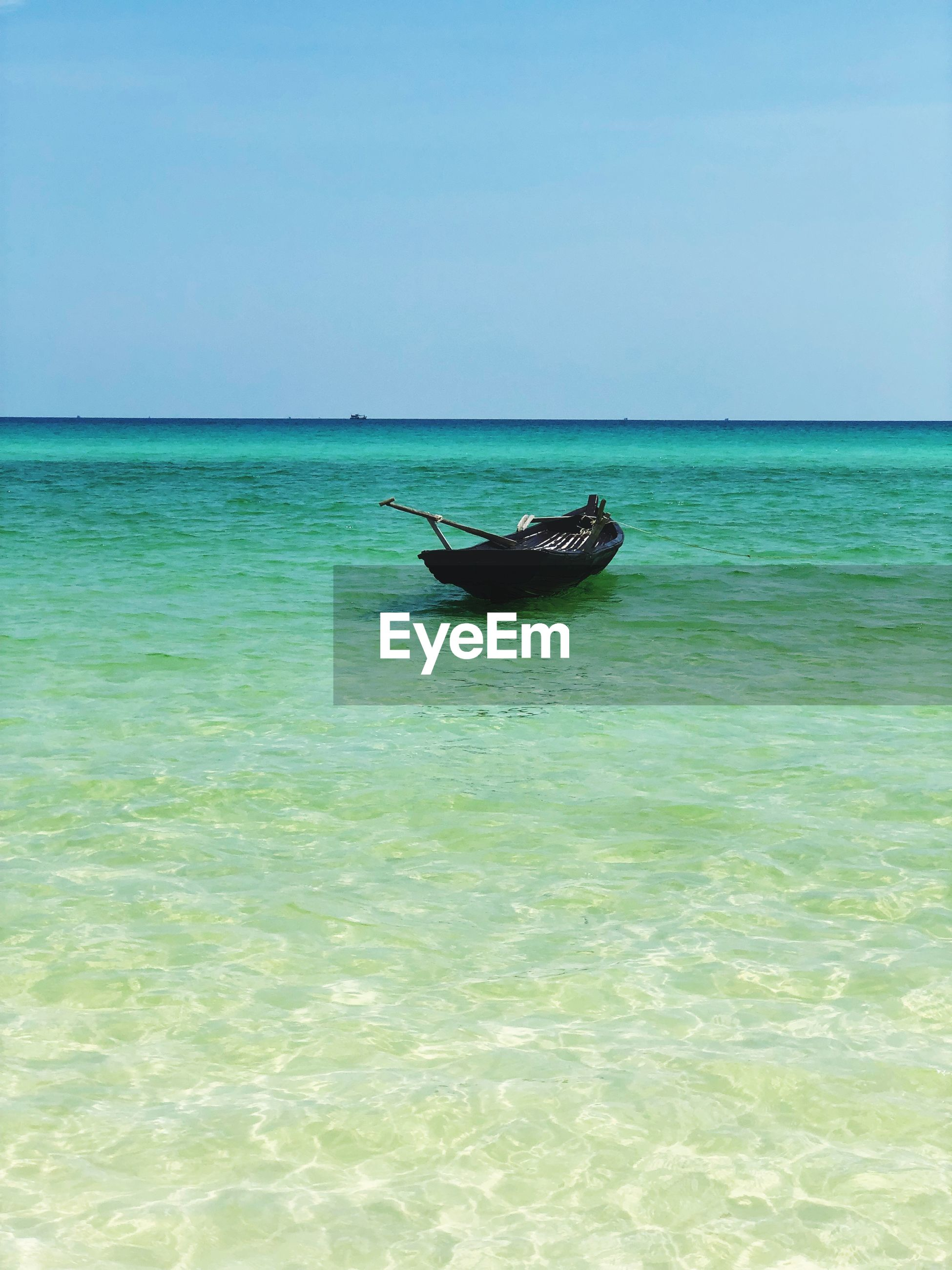 VIEW OF BOAT IN SEA AGAINST CLEAR SKY