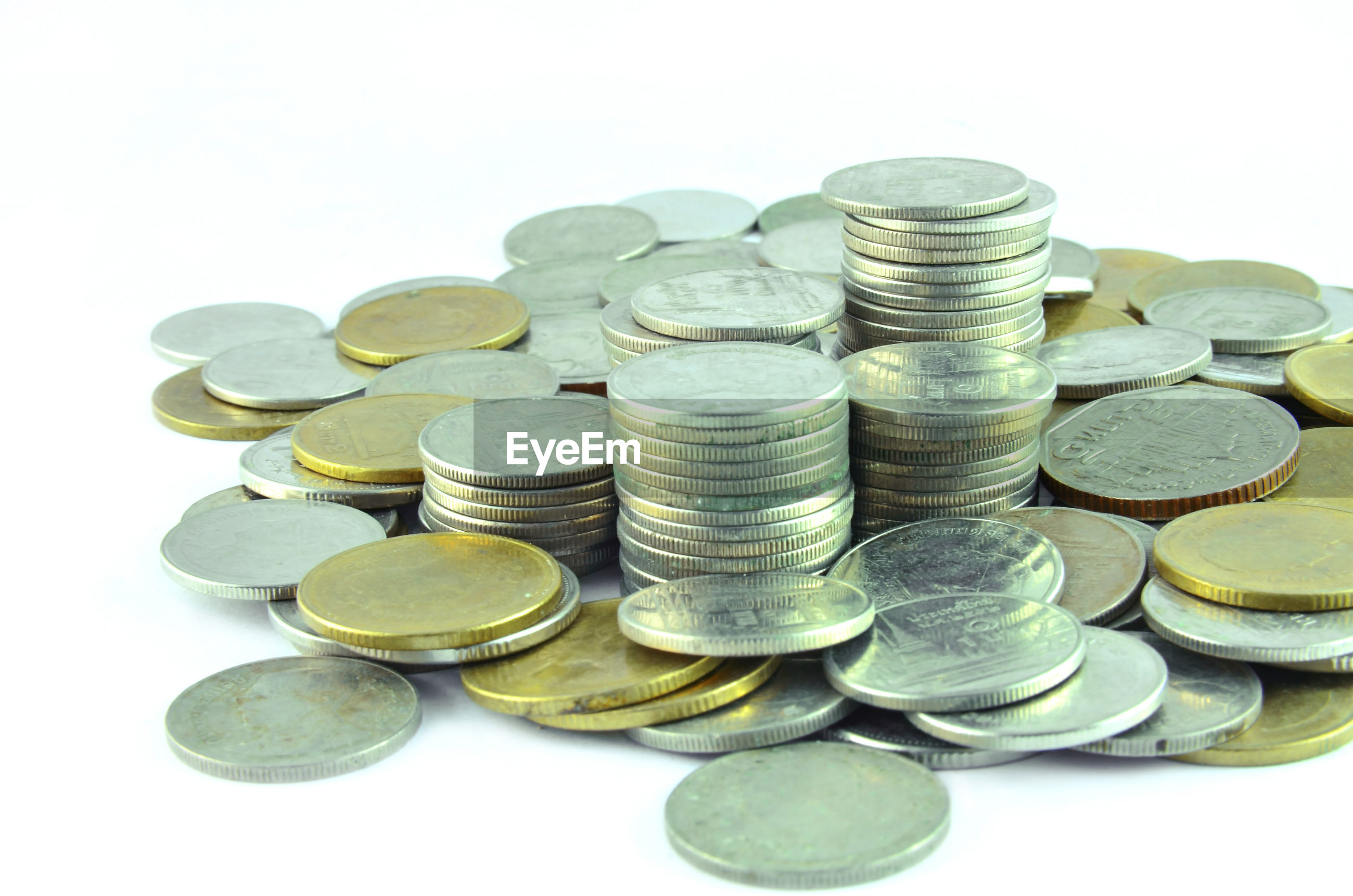 Stack of coins against white background