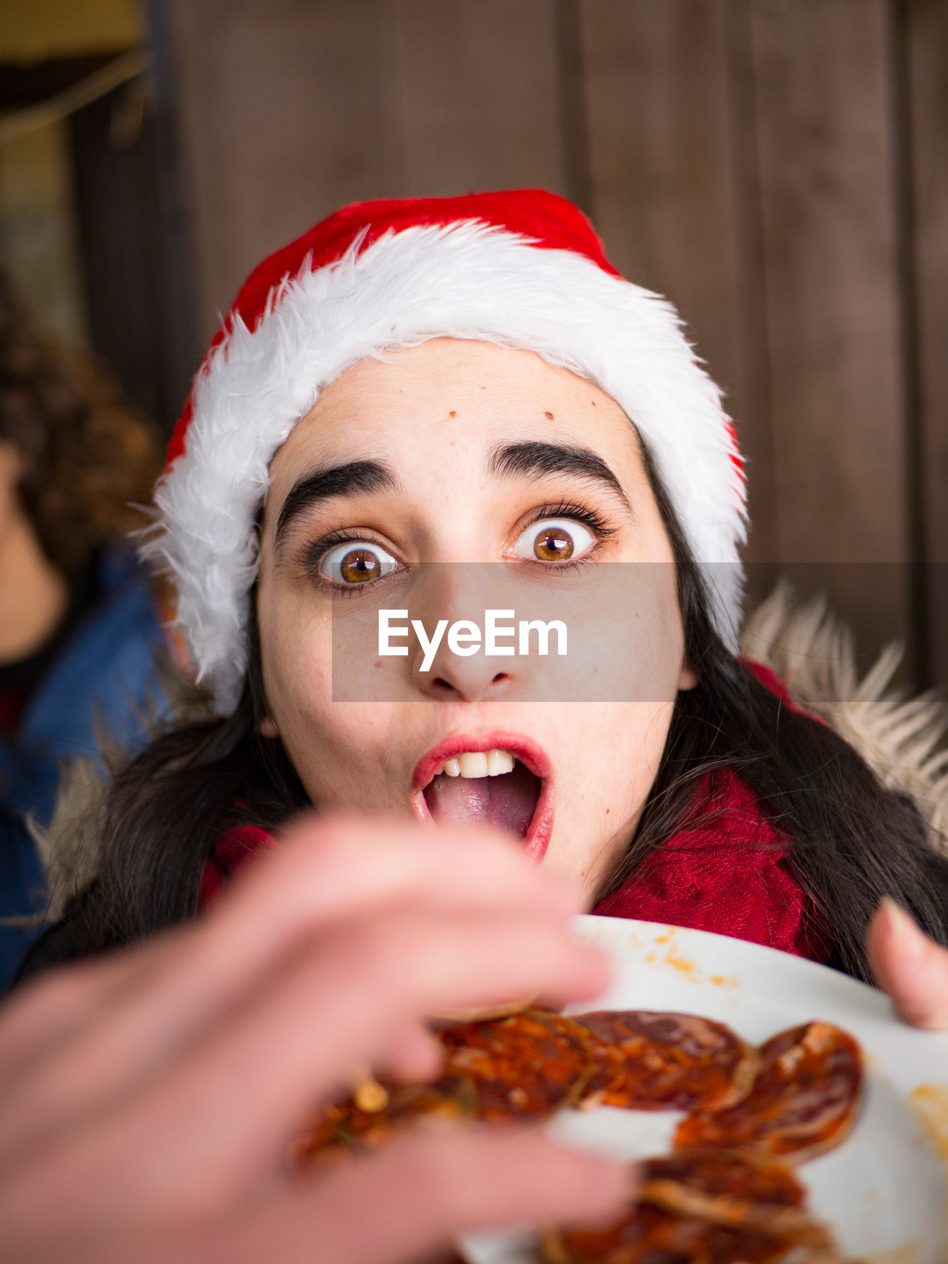 Close-up of woman having food during christmas