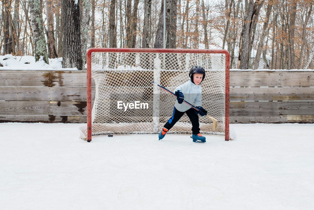 Portrait Of Boy Playing Ice Hockey
