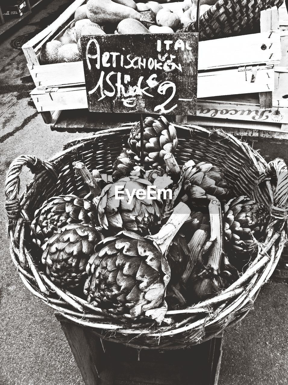 Elevated view of basket of artichokes on market