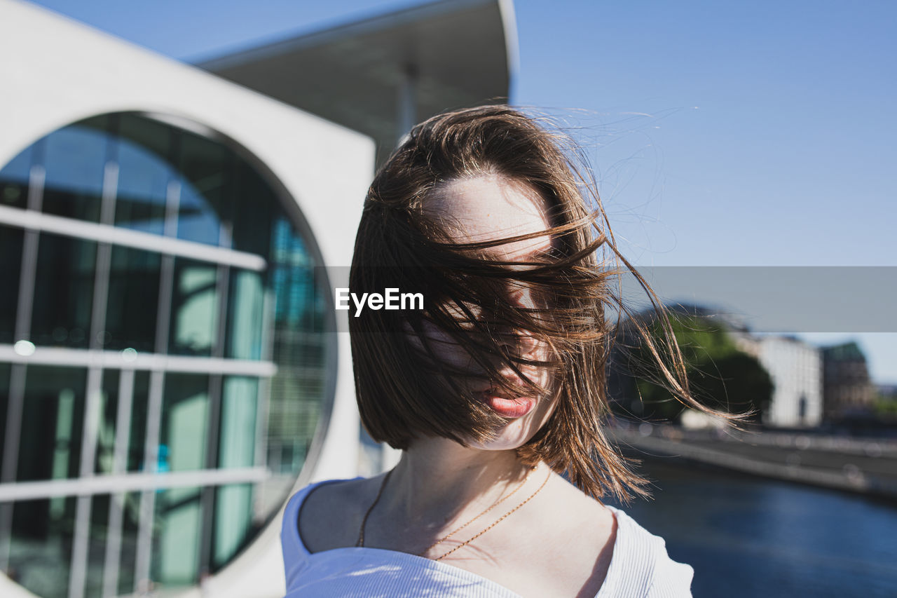Portrait of woman in front of building