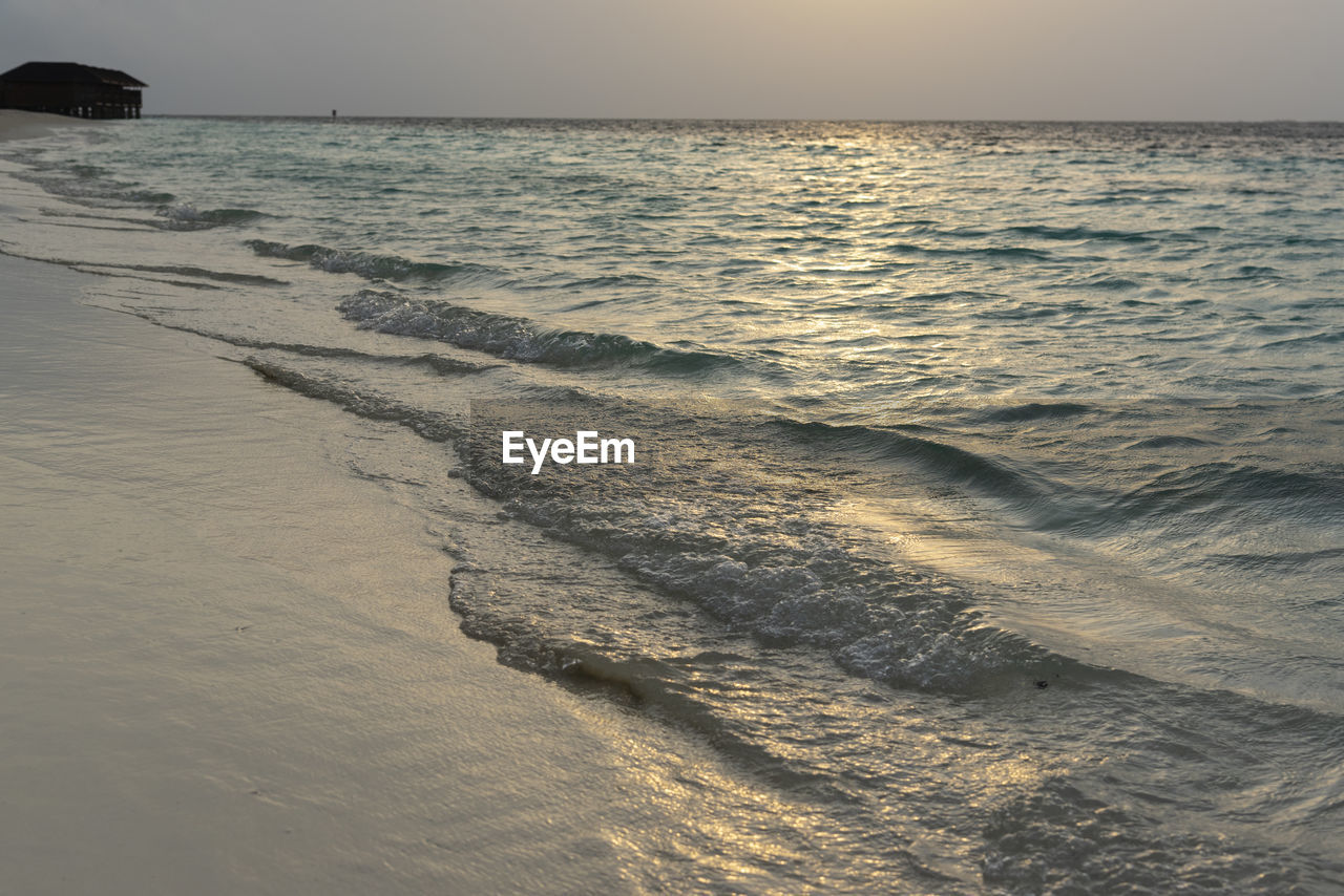 sea, water, beach, horizon over water, horizon, sky, land, scenics - nature, beauty in nature, sand, tranquility, nature, motion, tranquil scene, no people, wave, sport, aquatic sport, sunset, outdoors