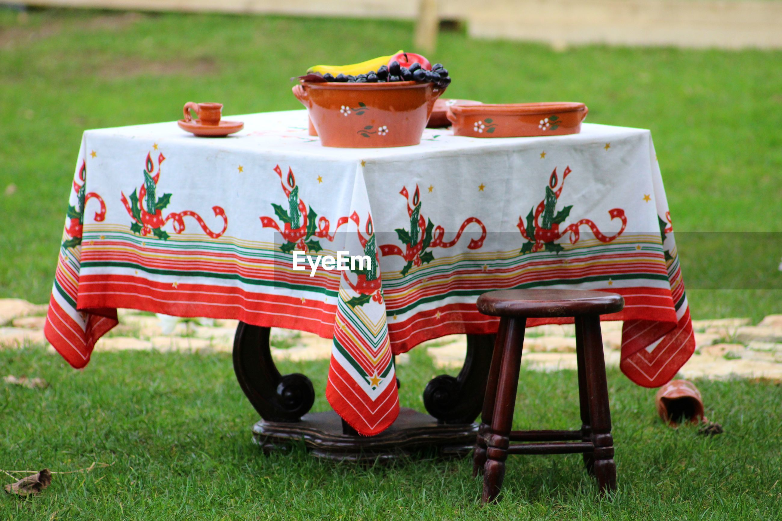 Close-up of red table setting on field in park