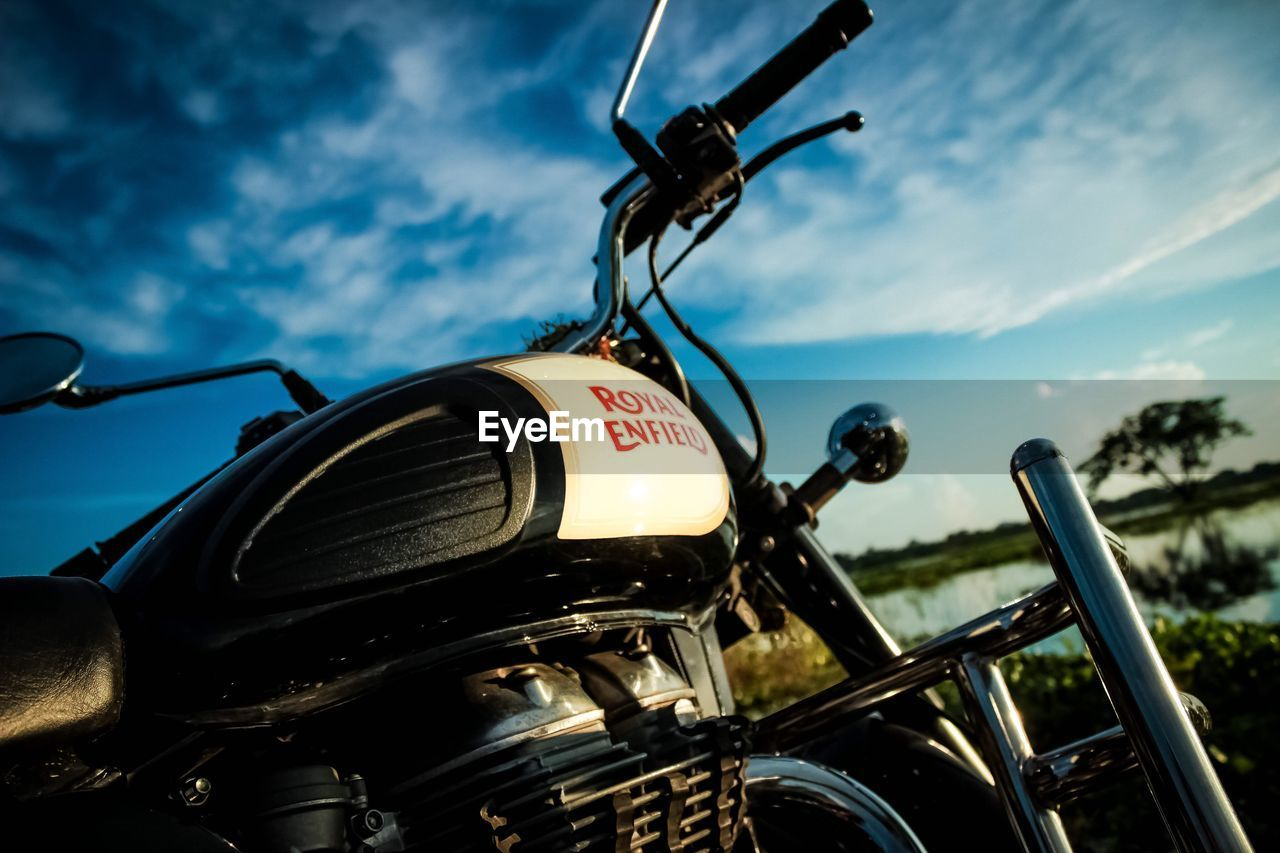 mode of transport, transportation, land vehicle, sky, cloud - sky, motorcycle, outdoors, day, stationary, close-up, no people, speedometer
