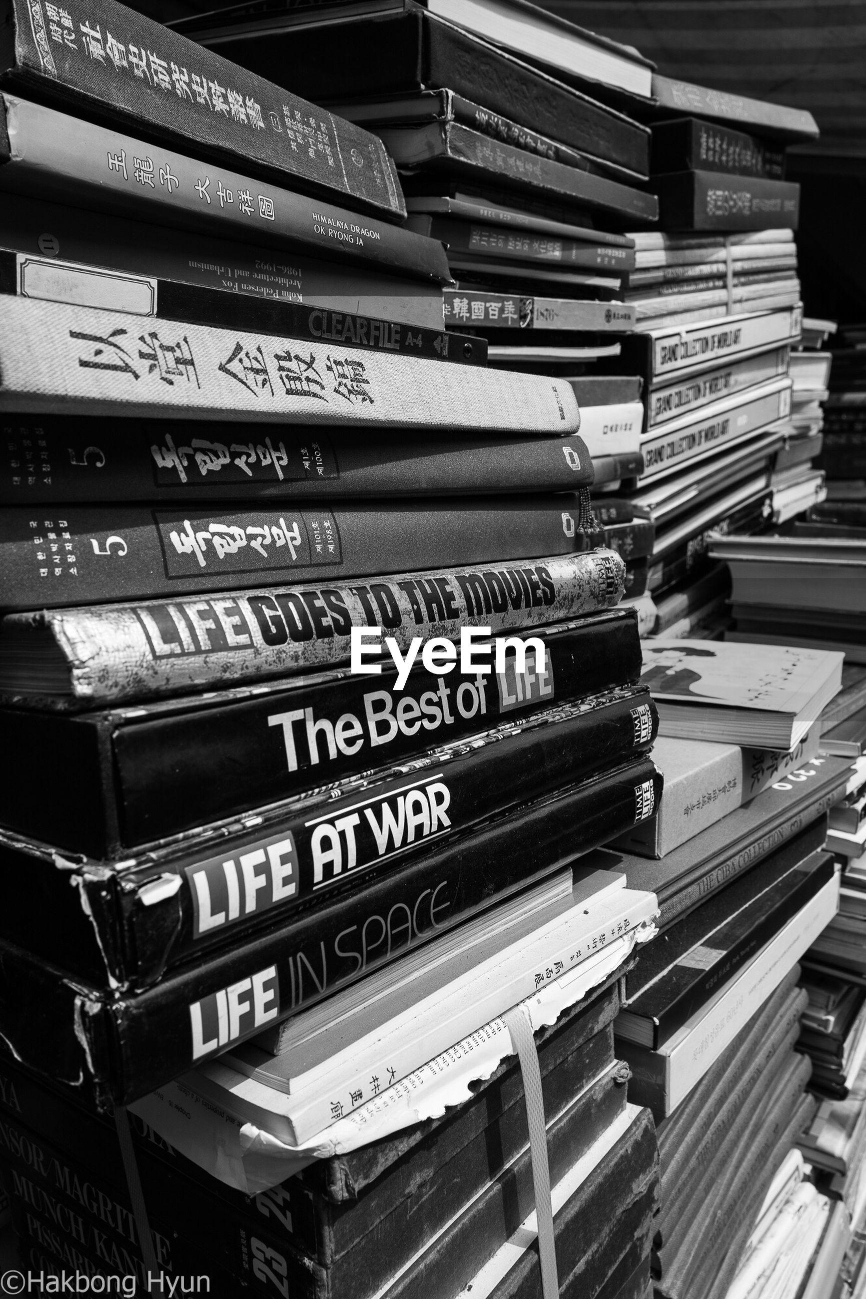 stack, large group of objects, communication, book, abundance, arrangement, choice, no people, indoors, library, shelf, education, bookshelf, day, close-up