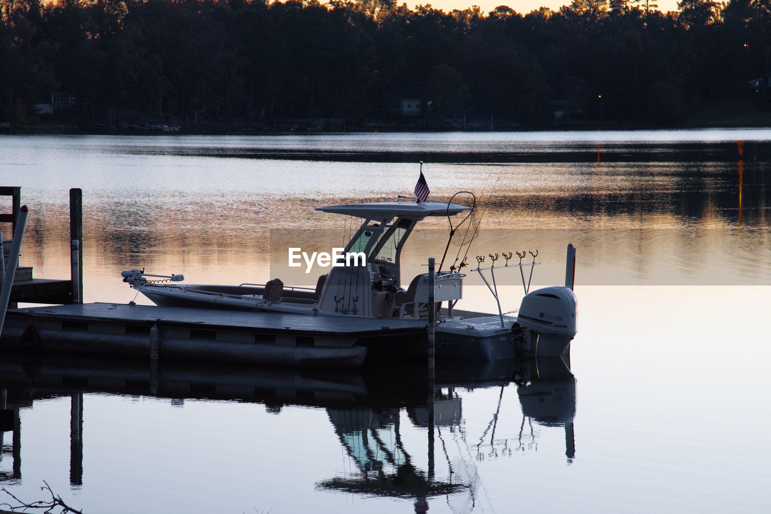 BOAT MOORED AT LAKE AGAINST SKY