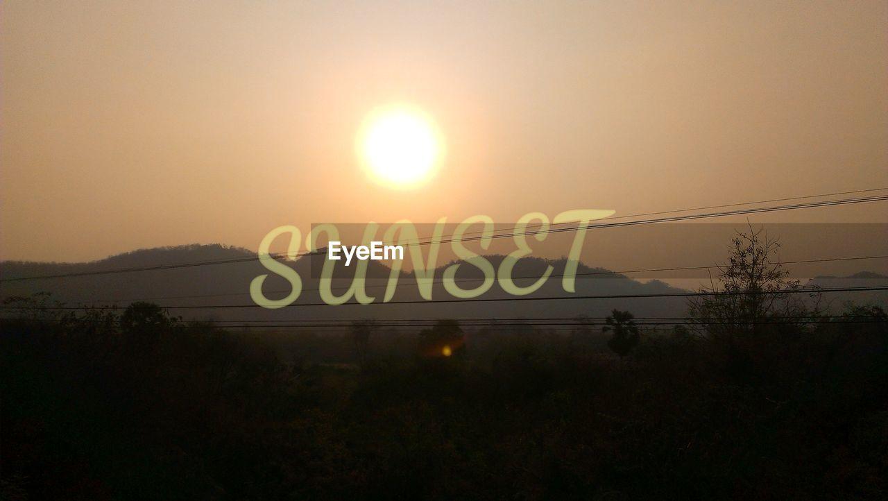 INFORMATION SIGN AT SUNSET