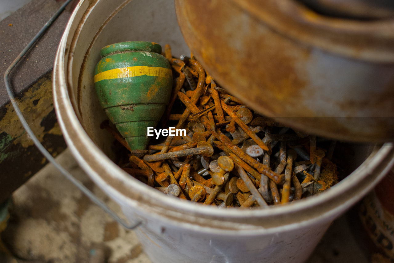 High angle view of rusty nails and in container