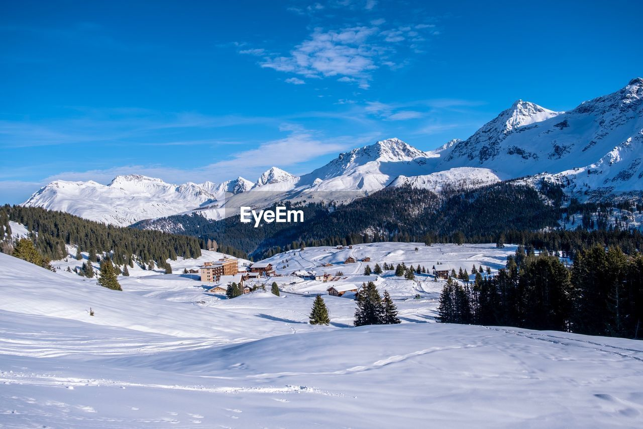 snow, cold temperature, winter, mountain, scenics - nature, beauty in nature, sky, tranquil scene, mountain range, environment, snowcapped mountain, tranquility, blue, landscape, non-urban scene, nature, cloud - sky, white color, built structure, no people, mountain peak