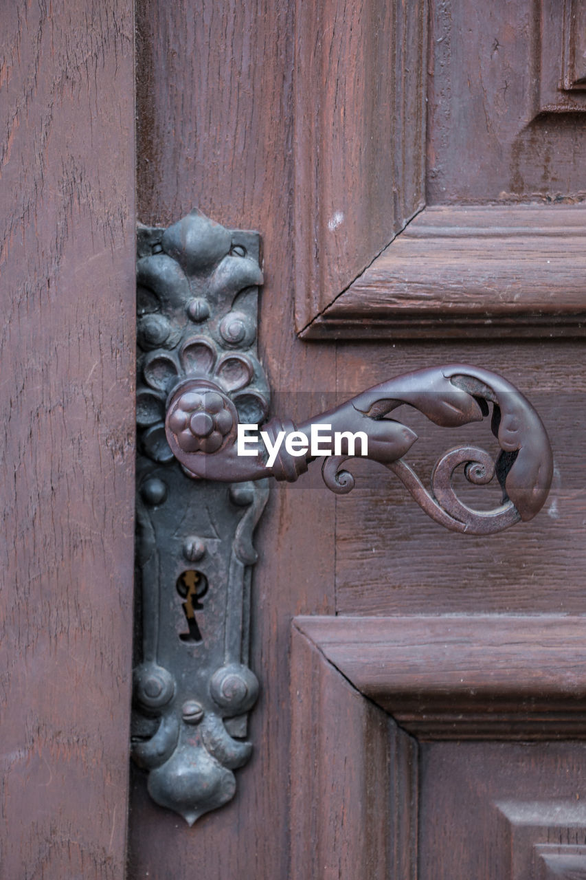 door, entrance, wood - material, metal, no people, day, protection, door knocker, security, knob, safety, art and craft, doorknob, animal representation, close-up, representation, creativity, closed, craft, design, outdoors, ornate