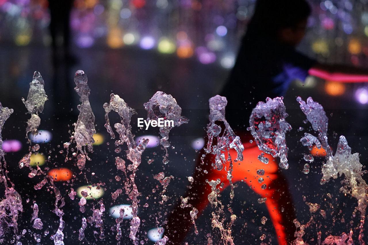Close-Up Of Illuminated Water At Night
