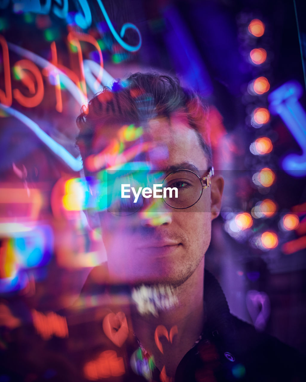 illuminated, headshot, portrait, glasses, one person, eyeglasses, real people, night, multi colored, glowing, leisure activity, front view, light - natural phenomenon, lifestyles, adult, technology, mid adult, focus on foreground, men, nightlife, light