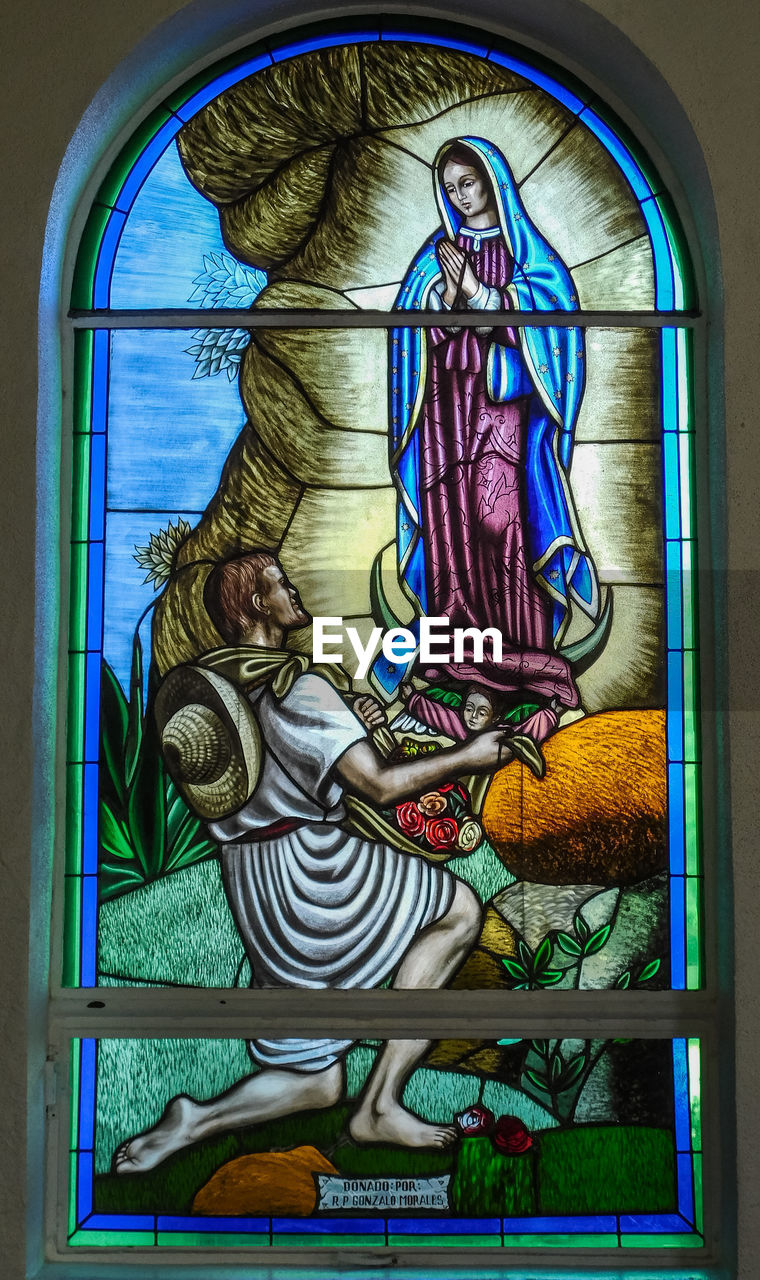 representation, art and craft, human representation, creativity, religion, belief, glass - material, spirituality, indoors, female likeness, no people, architecture, stained glass, male likeness, place of worship, window, multi colored, glass
