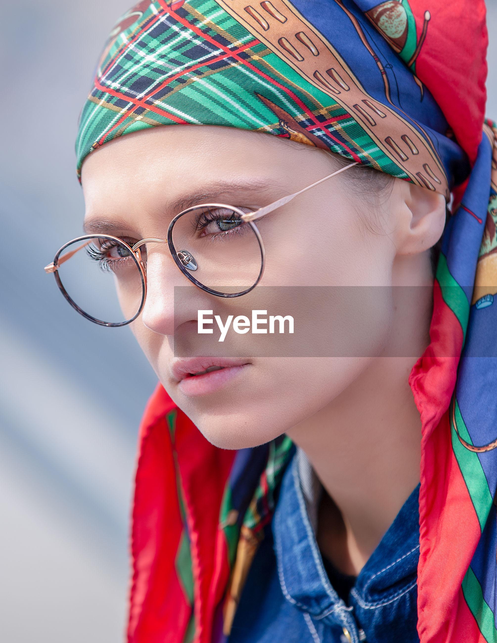 Close-up of woman wearing eyeglasses and bandanna