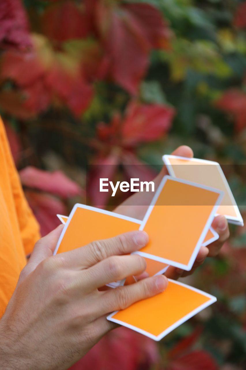 Close-up of man shuffling cards
