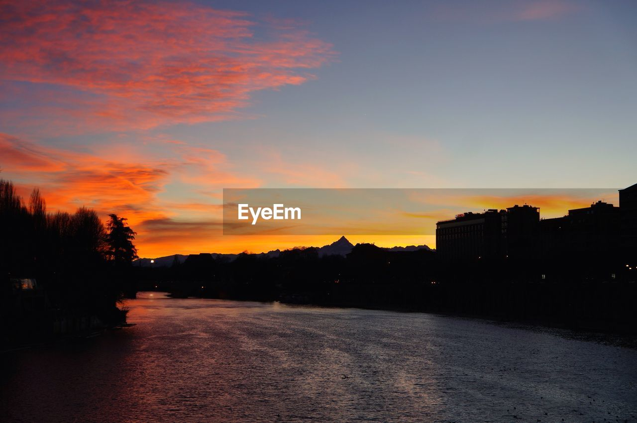 Scenic view of river during sunset